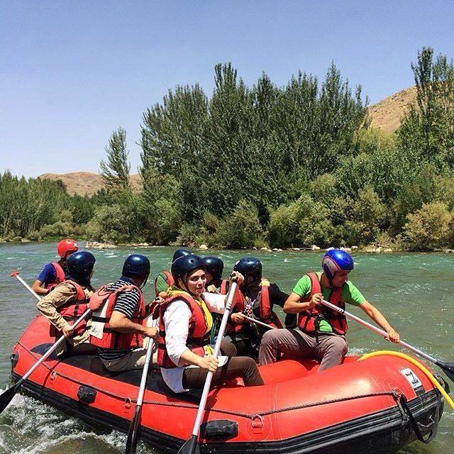 Iranian young people rafting in river