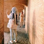 Girls taking photo under the old bridge in Isfahan