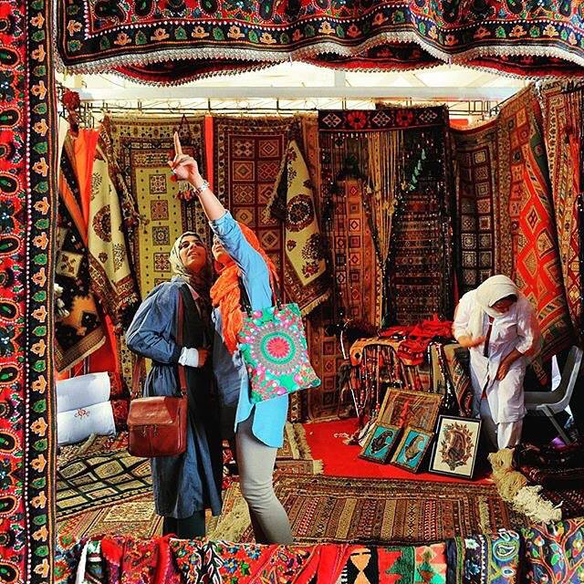 Women visiting ‪‎Iran‬'s carpet.