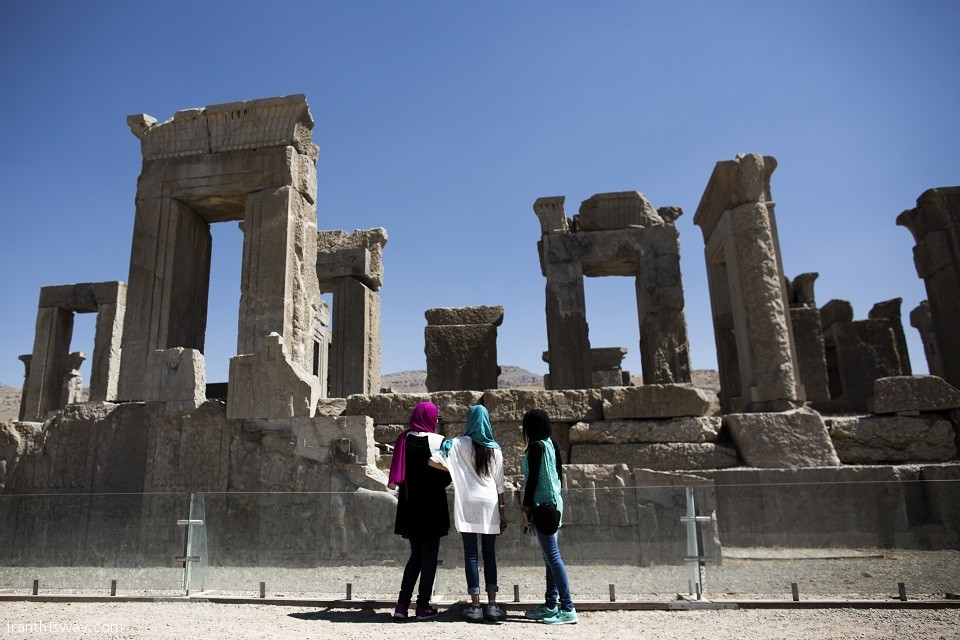 Iranian women look at the palace of King Darius of Achaemenid (522-486 BC) in the ancient Persian city of Persepolis near Shiraz in southern Iran on September 26, 2014. Persepolis, is one of the greatest architectural complexes of the ancient world, built atop a huge limestone platform. It was the main royal residence and ceremonial center of the Achaemenid empire of Persia (550-330 BC), but was later burned and plundered by Alexander the Great in 330 BC. AFP PHOTO/BEHROUZ MEHRI