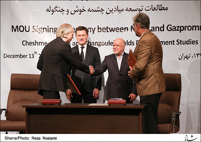 Iran signed preliminary agreements with Russia's Gazprom on Tuesday to develop two major oilfields in the latest of a flurry of deals with foreign firms, local media reported.