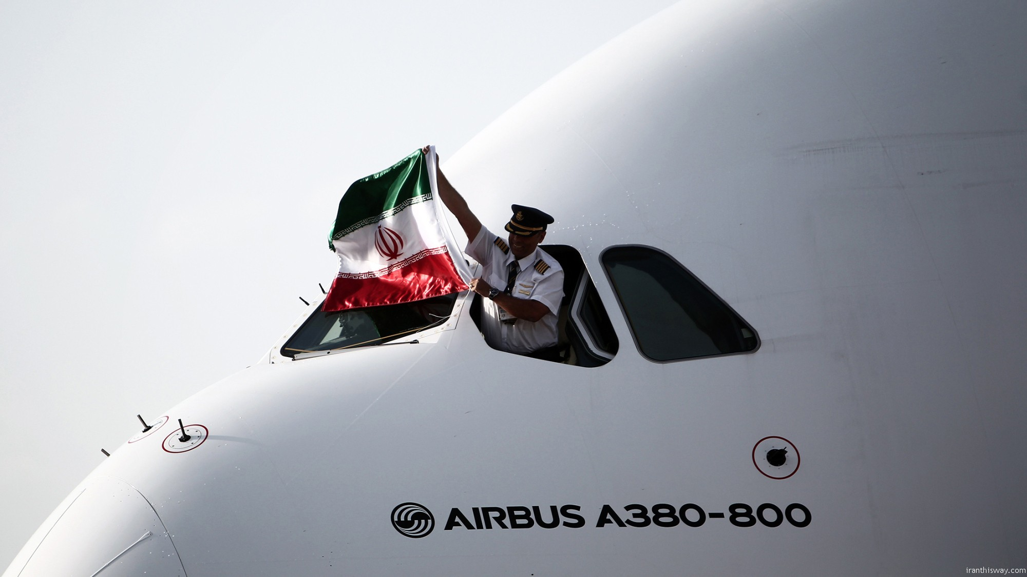 Iran and the European aviation giant Airbus signed a contract on Thursday to sell 100 jets to Iran Air, paving the way for deliveries to start next month, a year after sanctions against the country were lifted.
