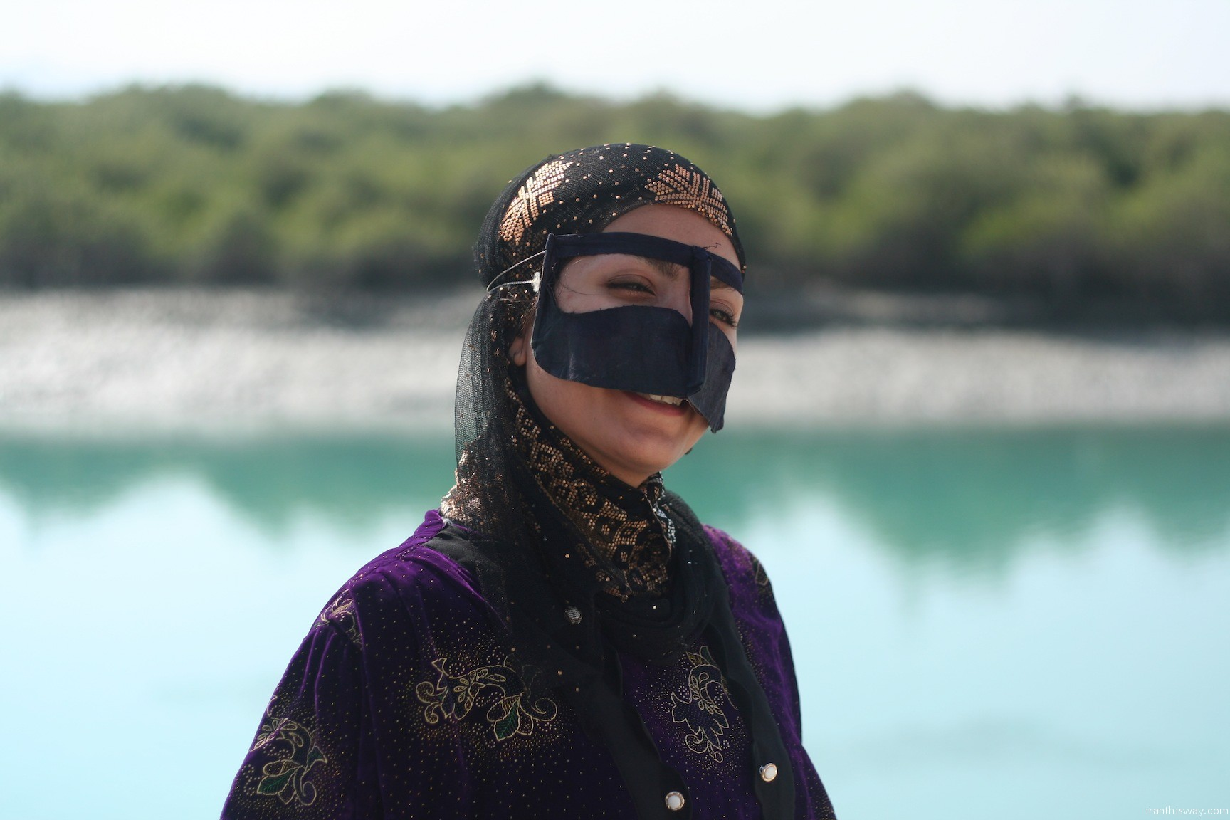 Iranian girl with traditional cover in Qeshm island, Persian Gulf