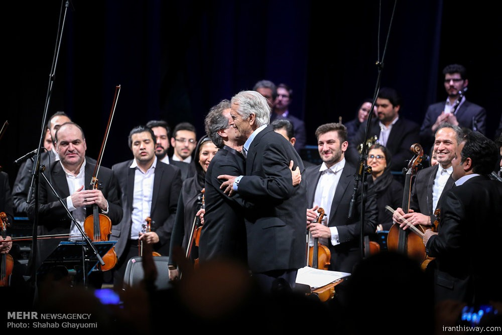 Photo: Tehran Symphony Orchestra conductor Shahrdad Rohani (R) and composer Ahmad Pejman are seen in an undated photo.