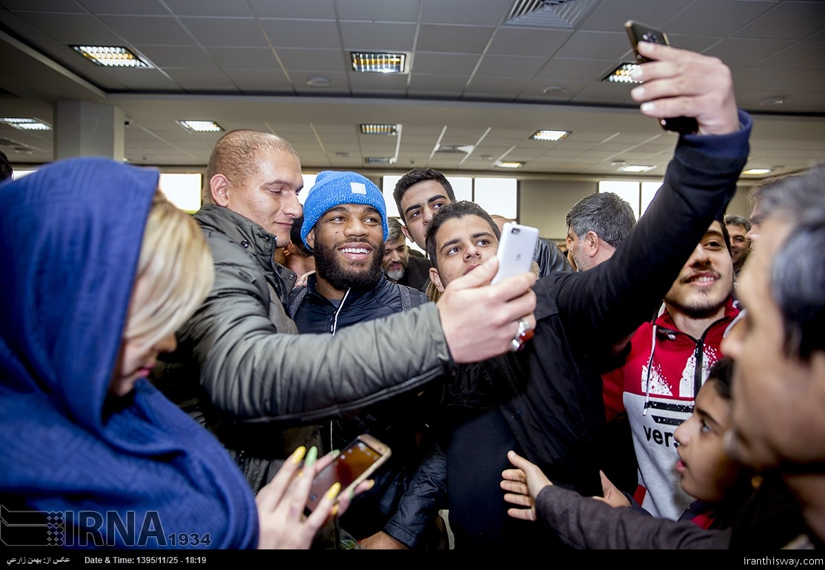 American freestyle wrestler Jordan Ernest Burroughs (C) receives warm welcome from Iranian wrestling fans and reporters upon arrival at Shahid Ashrafi Esfahani Airport in the western Iranian city of Kermanshah on February 13, 2017.
