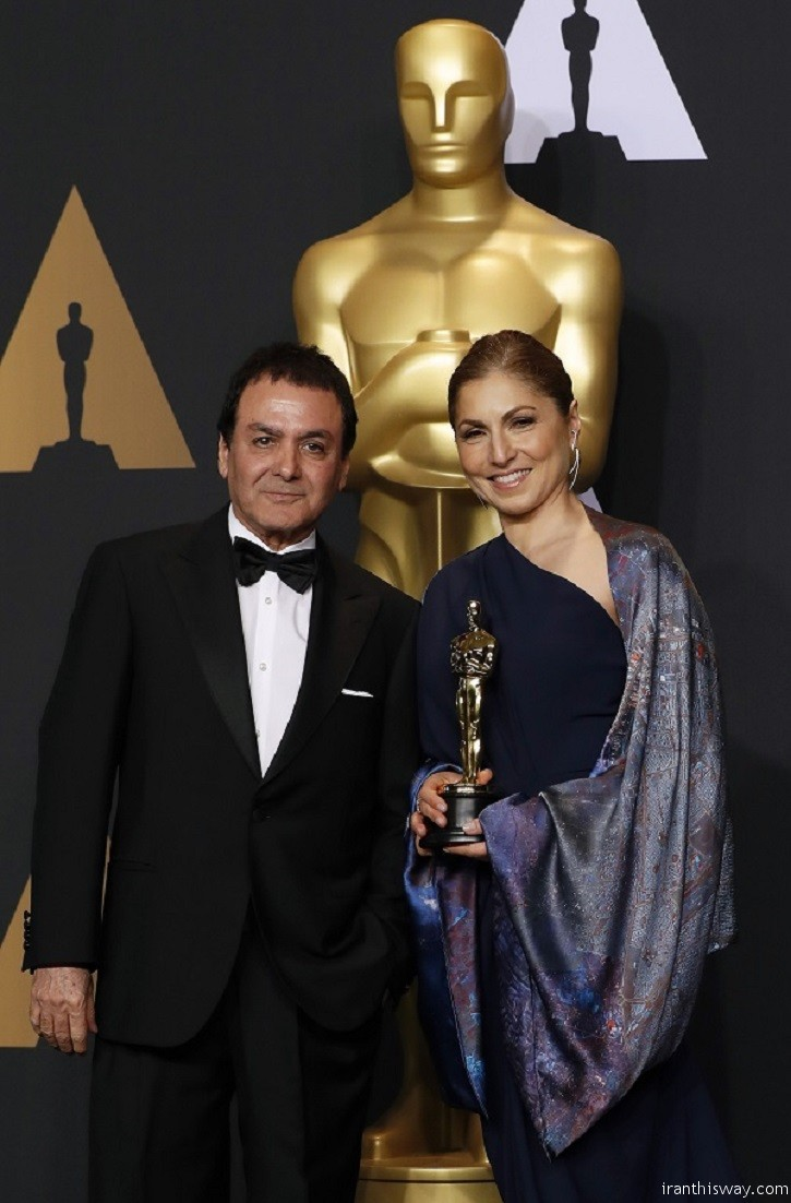 "89th Academy Awards - Oscars Backstage - Hollywood, California, U.S. - 26/02/17 - Anousheh Ansari and Firouz Naderi pose with the Oscar they accepted on behalf of Asghar Farhadi, who won the Best Foreign Language Film for ""The Salesman"". REUTERS/Lucas Jackson - RTS10HRP"